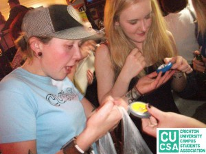 Dishing out some free condoms a a CUCSA event